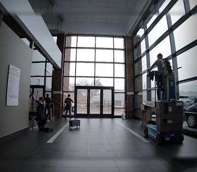We are cleaning the inside windows and using a lift to reach the highest windows and we clean the frames as well.